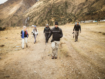 hikers with hiking sticks