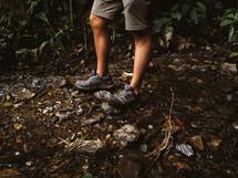 man wearing hiking shoes