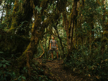 man standing in a jungle