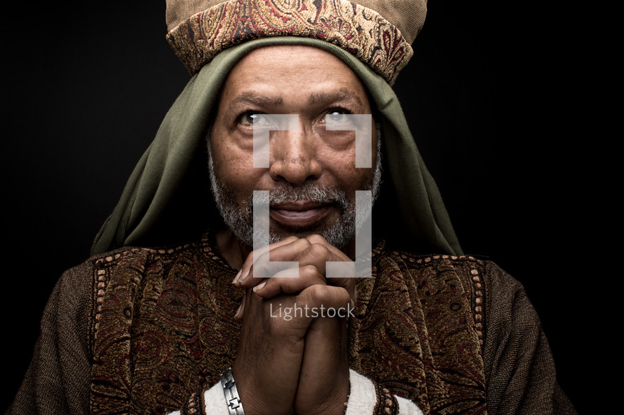 a wiseman with praying hands