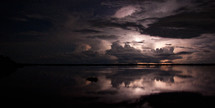 A lighting storm rolls over the Amazon river at night.