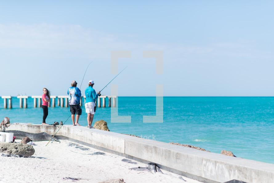 men fishing on a shore