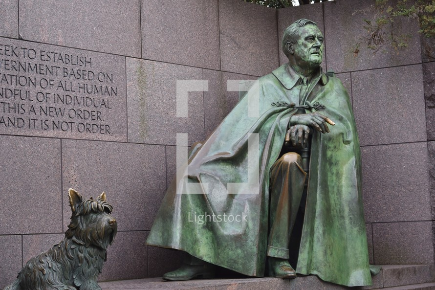 statue of a man with a dog