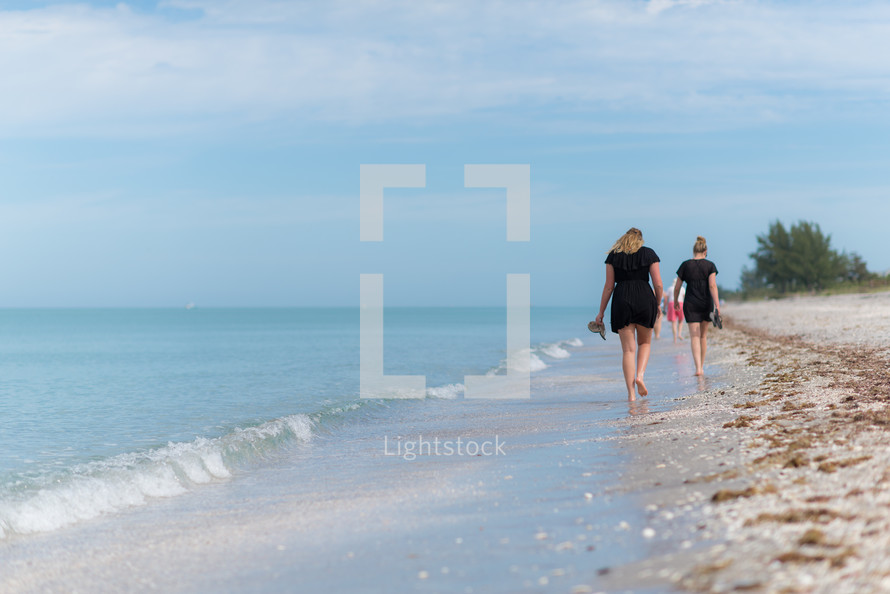 girls walking on a beach