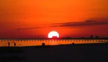 Gulf coast sunset in a red sky.