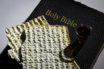 Communion elements sitting on top of closed bible