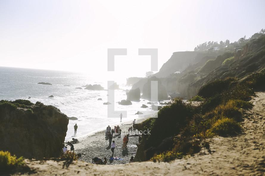 people on a rocky beach