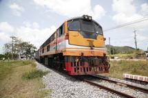 A train moving along railroad tracks.