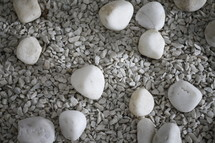 white stones on crushed granite