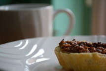 pastry on a plate and mug