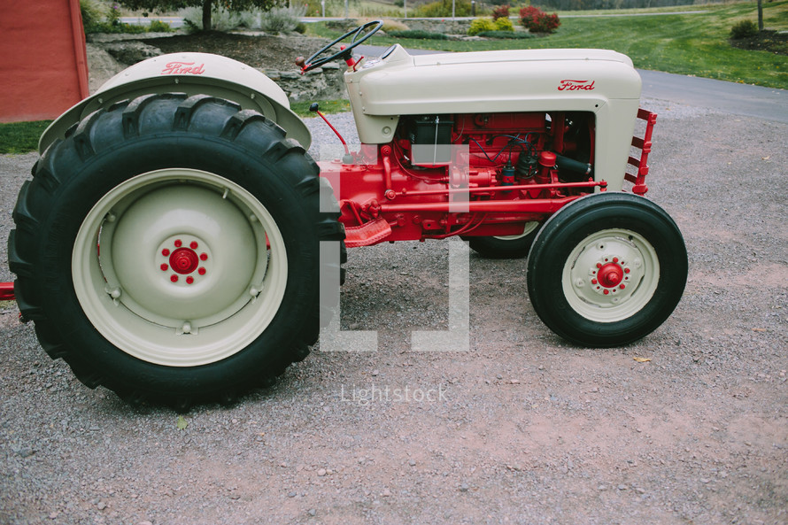 red and white Ford tractor