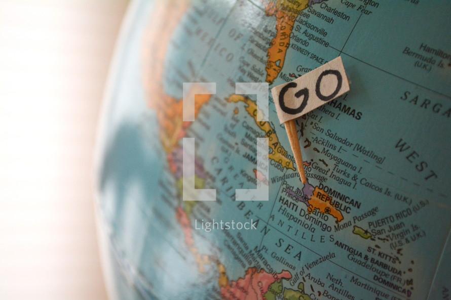 GO sign on a globe