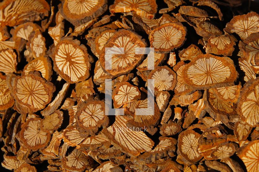 pile of cross grain cut discs of tree limb
