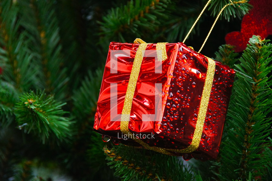red present ornament on a Christmas tree