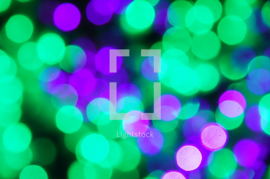 green and purple bokeh lights