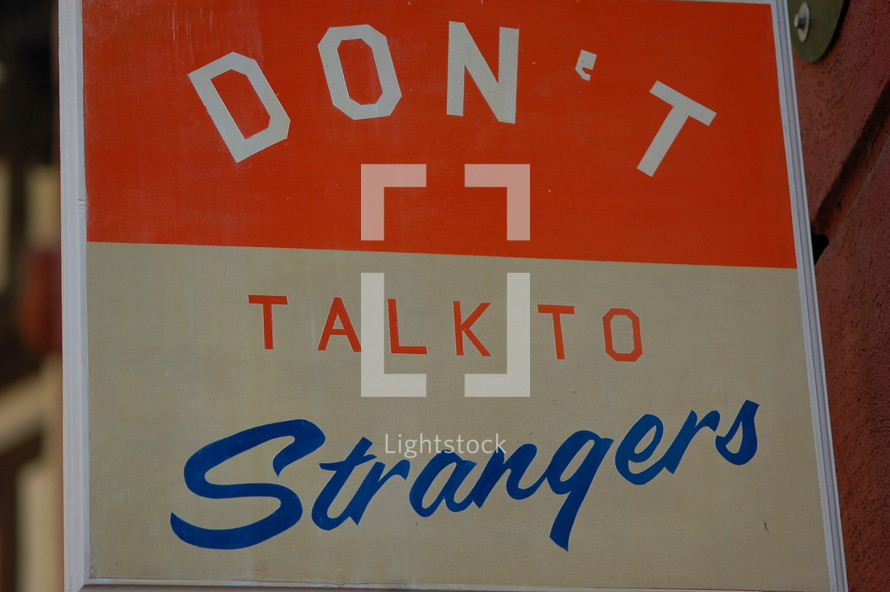 "A sign that says, ""Don't talk to strangers."""