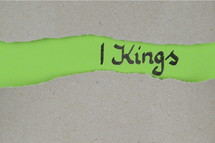 Title 1 Kings - torn open kraft paper over green paper with the name of the book 1 Kings