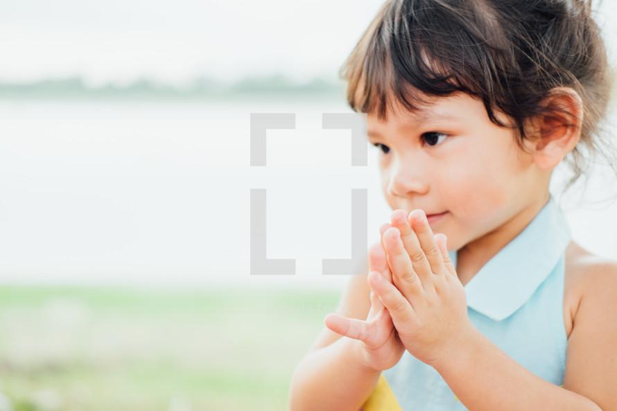 praying girl child
