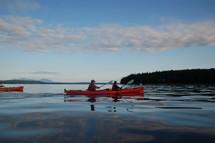 men paddling in a canoe