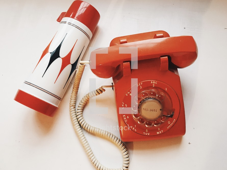 thermos and vintage rotary phone
