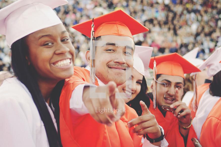 pointing high school graduates