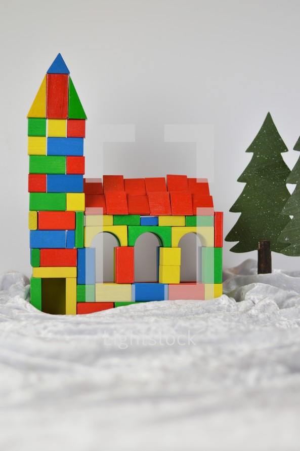 church made out of multicolored different wooden toy blocks as symbol for the community of believers