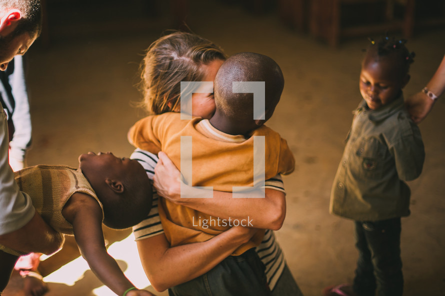 missionary hugging a child