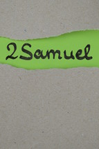 torn open kraft paper over green paper with the name of the book 2 Samuel