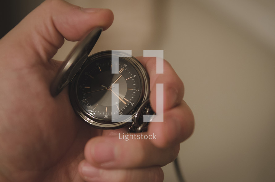 a man with a pocket watch