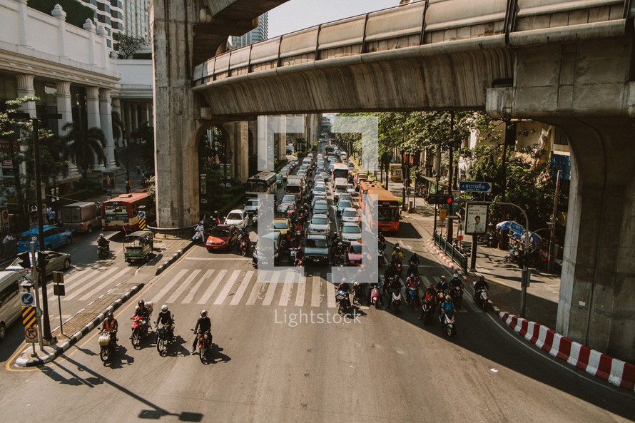 Heavy traffic on a city street in Thailand.