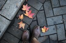 boots on a sidewalk in fall