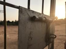 sunlight on a gate door