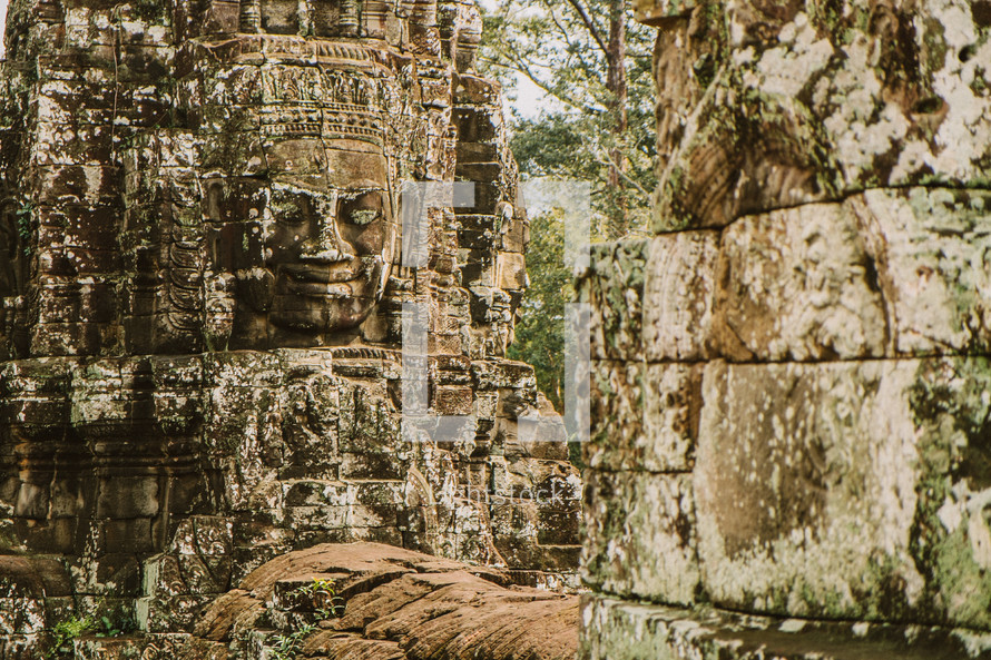 carvings in stone in a temple in Cambodia