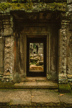 entrance to a temple in ruins  in Cambodia