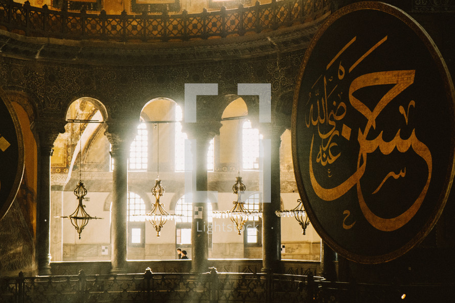 Light shining through windows in a Mosque.
