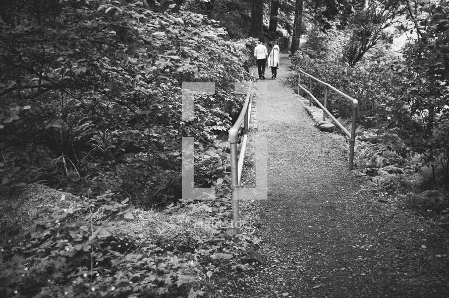 Couple walking park trail