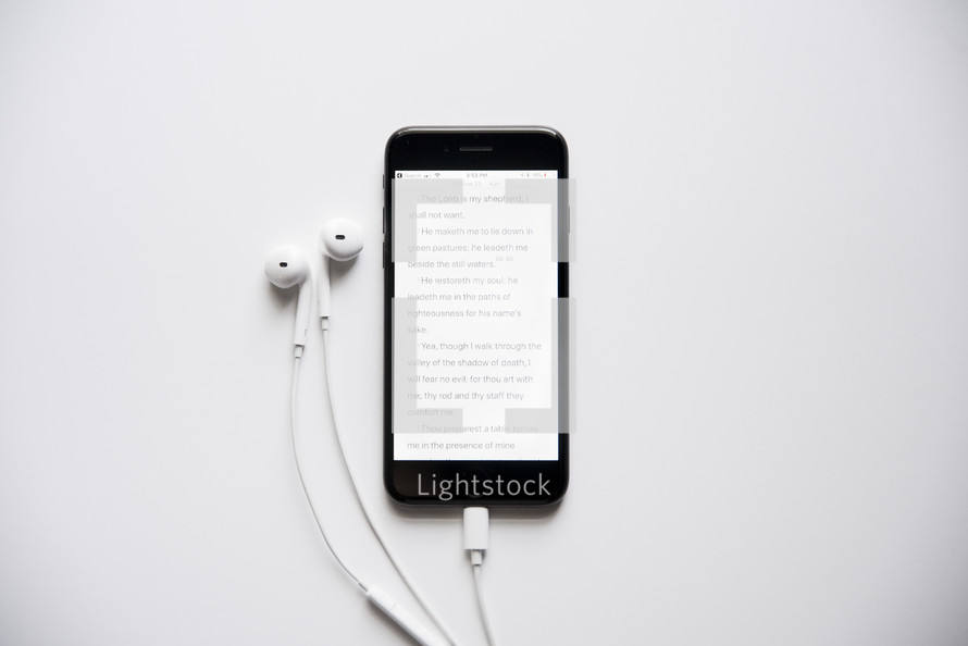 earbuds and Bible app