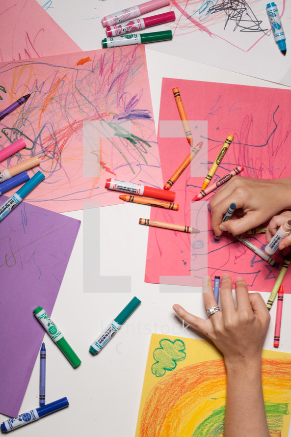 a child drawing on construction paper