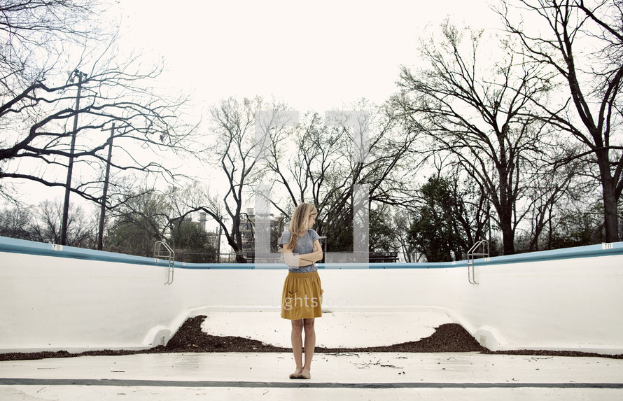 woman standing in an empty pool
