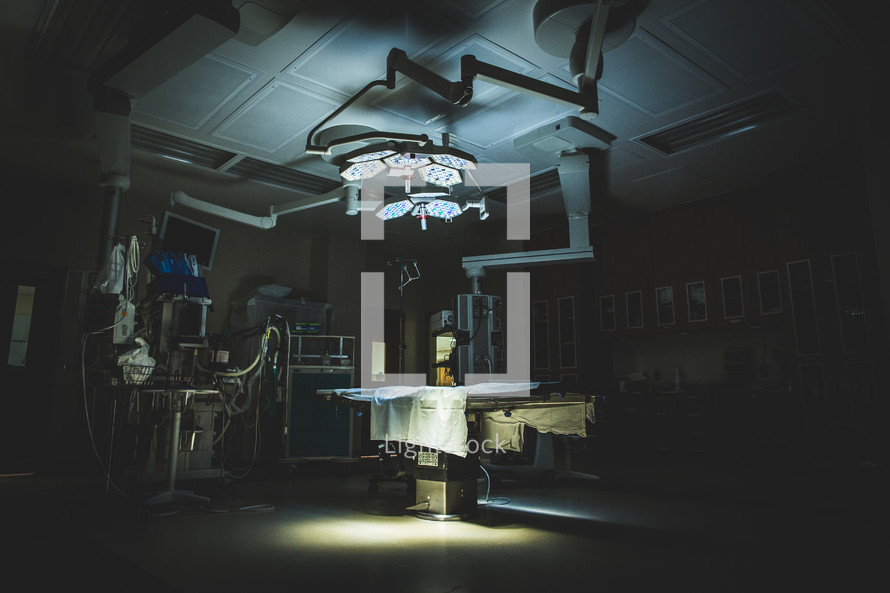 Dimly lit operating room.