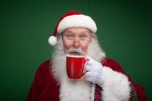 Santa holding a mug