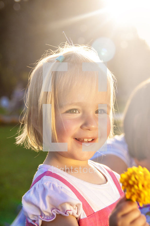 a happy girl child outdoors