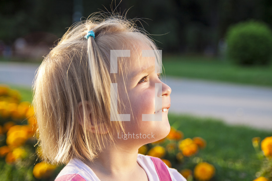 girl child looking up to God