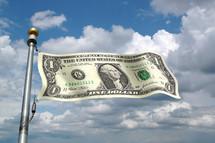 A one dollar bill as a flag on a flagpole against the sky.