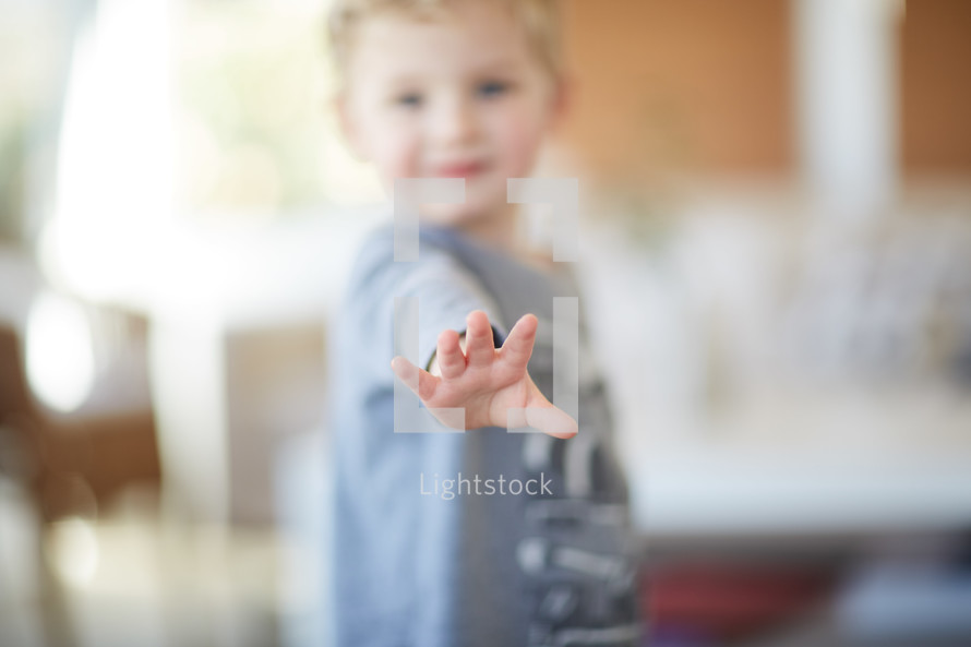 a toddler's reaching hand