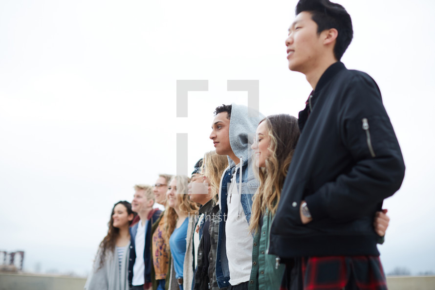 row of young people standing together