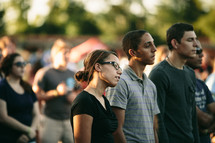 people gathered to listen to christian music at an outdoor concert