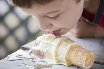 licking a dropped ice cream cone