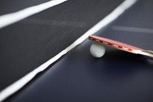 closeup of paddle and ball for table tennis.