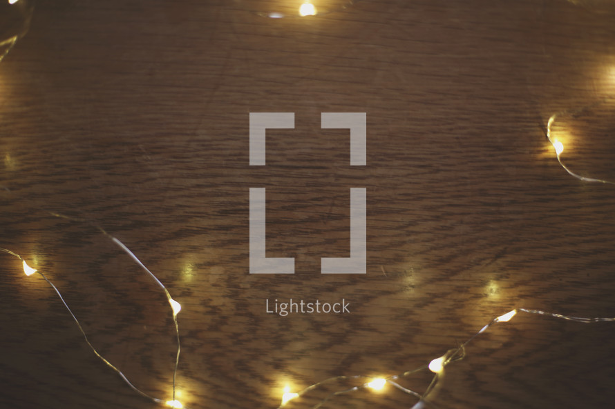 small lights form a border on a wood background